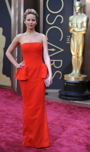 """Nominee for Best Supporting Actress in """"American Hustle"""" Jennifer Lawrence arrives on the red carpet for the 86th Academy Awards on March 2nd, 2014 in Hollywood, California. AFP PHOTO / Robyn BECK"""