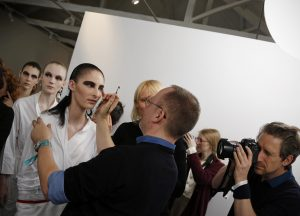 Creative and Image Director of Make-Up at Christian Dior, Peter Philips (C), applies finishing make-up touches to a model ahead of the Dior Cruise fashion show at Blenheim Palace in Woodstock, near Oxford, central England on May 31, 2016., Image: 288188303, License: Rights-managed, Restrictions: , Model Release: no, Credit line: Profimedia, AFP